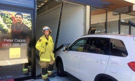 Elderly woman crashes through shopfront in Coast complex