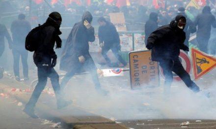 Paris police arrest 200 after violent May Day riots