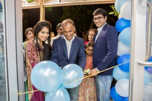Dr. Ram Mohan, President, FICQ, cutting the ribbon during inauguration ceremony