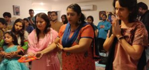 Sevaks doing Aarthi during Calamvale celebrations