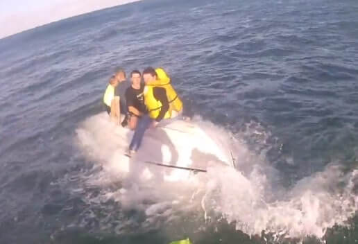 Four People Pulled into Rescue Chopper after Boat Overturns