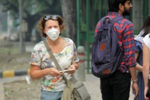 New Delhi: A woman wears mask to protect herself from air pollution as toxic haze continues to engulf the national capital, on Nov 13, 2019. The Delhi air quality index (AQI) is at emergency levels again on Wednesday with an overall count of 476 and not much relief is expected for the next two days till Friday. While overall AQI is in the severe category, PM10 count is at 489 and PM2.5 at 326 is also in the severe category. (Photo: IANS)