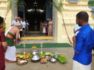 Pandit Ji performing Pongal puja in front of the temple