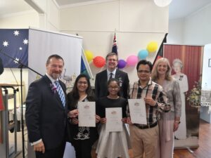 Mr Graham Perrett MP (left) Senator Paul Scarr (back) and Cr Angela Owen posing with the new citizens